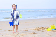 Happy child playing on the beach Stock Photos