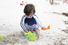 Happy Child Playing On The Beach Stock Image