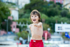 Happy child, playing on the beach summertime Royalty Free Stock Photos