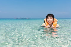 Happy child playing in beautiful sea Stock Photos