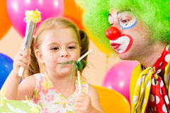 Happy child playing with clown on birthday party Stock Image