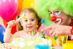 Happy child playing with clown on birthday party Stock Photography