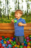 Happy child playing with colorful plastic balls Royalty Free Stock Photo