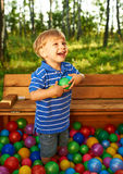 Happy child playing with colorful plastic balls Stock Photo