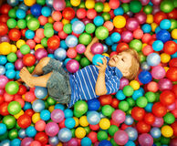 Happy child playing with colorful plastic balls Stock Photography