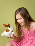 Happy Child playing with Easter Bunny Stock Photos