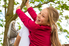 Happy child playing in the garden stock images