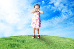 The happy child playing a glade Stock Images