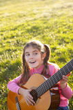 happy child playing guitar Stock Images