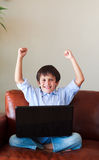 Happy child playing with his laptop Royalty Free Stock Photo