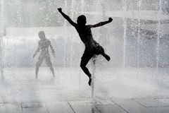 Happy child playing and jumping Stock Photography