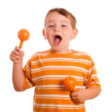 Happy child playing maracas and signing Stock Photo
