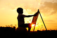 Happy child playing on meadow Royalty Free Stock Images