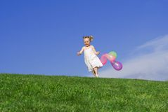 Happy child playing outdoors stock photography