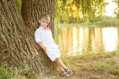 Happy child playing outdoors in autumn park Royalty Free Stock Image
