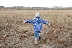 Happy child playing outdoors. royalty free stock photos