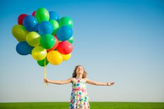 Happy child playing outdoors in spring field royalty free stock photos
