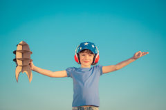 Happy child playing outdoors Royalty Free Stock Images