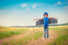 Happy child playing outdoors Royalty Free Stock Photos