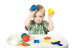 Happy child playing with plasticine. Colorful balls Royalty Free Stock Photography