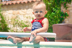 Happy child  playing in the pool Royalty Free Stock Image
