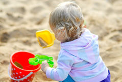 Happy child playing with sand in summer Stock Photos