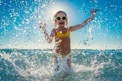 Happy child playing in the sea Stock Image