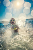 Happy child playing in the sea Royalty Free Stock Image