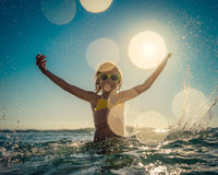 Happy child playing in the sea Royalty Free Stock Photo