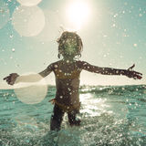 Happy child playing in the sea Royalty Free Stock Photography