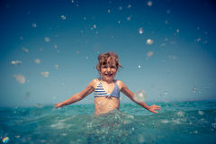 Happy child playing in the sea Stock Photography