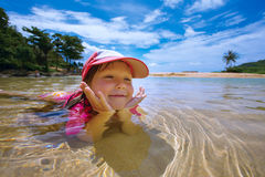 Happy child playing in sea Stock Photo