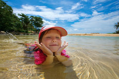 Happy child playing in sea Royalty Free Stock Images