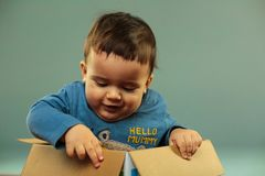 Little toddler in box stock photos