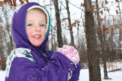 Happy child playing in a snow Royalty Free Stock Photography