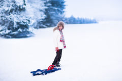 Happy child playing in snow Stock Images