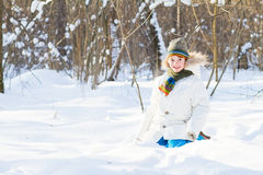 Happy child playing in a snow field Royalty Free Stock Images
