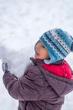 Happy child playing with snow Royalty Free Stock Photo