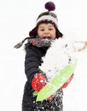 Happy child playing with snow in  winter Stock Photography