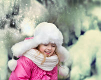 Happy child playing snowballs outdoor. Royalty Free Stock Photography