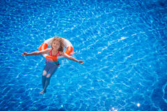 Happy child playing in swimming pool Royalty Free Stock Images