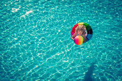 Happy child playing in swimming pool Royalty Free Stock Photography