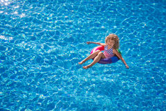 Happy child playing in swimming pool Stock Image