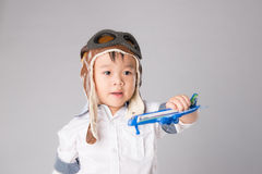 Happy child playing with toy airplane against summer sky Royalty Free Stock Image