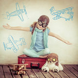 Happy child playing with toy airplane. At home. Retro toned Stock Photography