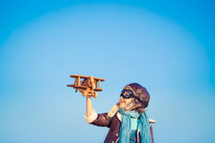 Happy child playing with toy airplane Stock Photography