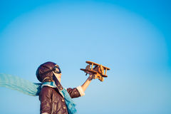Happy child playing with toy airplane Stock Image