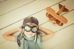 Happy child playing with toy airplane Stock Photos
