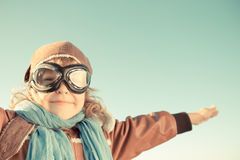 Happy child playing with toy airplane Royalty Free Stock Photos