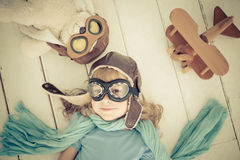 Happy child playing with toy airplane Stock Photo